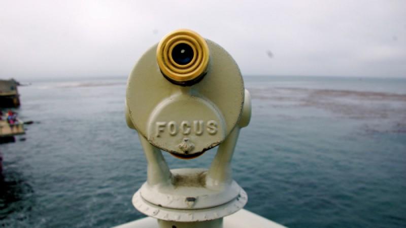 telescope overlooking water