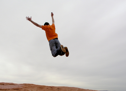 Guy leaping off cliff